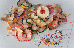 Pencil shavings. Colored pencil shavings on notebook sheet Royalty Free Stock Photography