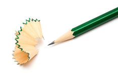Pencil and shavings isolated on white background Stock Photos