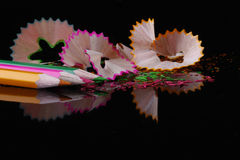 Pencil shavings and matching coloured pencils Stock Photos