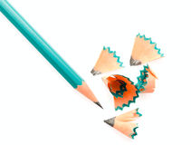 Pencil shavings. Sharpened pencil with shavings, close-up, isolated on Beom background stock image