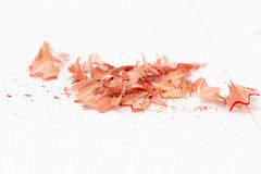 Pencil shavings on white paper. Royalty Free Stock Image