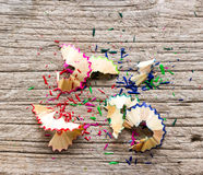 Pencil shavings on wood Royalty Free Stock Images