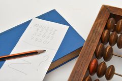 Pencil, sheet of paper and abacus Stock Photography