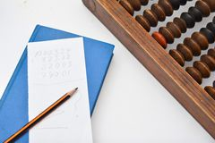 Pencil, sheet of paper and old abacus Royalty Free Stock Photography