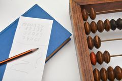 Pencil, sheet of paper and old abacus Royalty Free Stock Photos