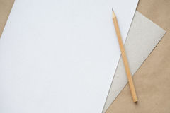 Pencil and sheet. On a table Royalty Free Stock Photos