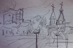 Pencil sketch of the city. Sketch from the nature of the city view, graphics. Square, trees, in the background a church and modern buildings. Drawing with a Stock Photography