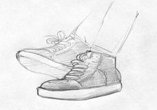 Pencil sketch of feet in gym shoes. Hand drawn pencil sketch of someone's feet in gym shoes Stock Images