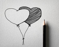 Pencil sketching for heart balloon concept. On white paper Stock Image