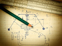 Pencil and a slide rule on the old page with the calculations Stock Photography