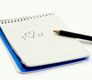 Pencil and small notebook Stock Photo