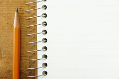 Pencil by Small Pad of Lined Paper Royalty Free Stock Images