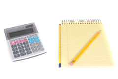 Pencil, spiral notebook and calculator Royalty Free Stock Images
