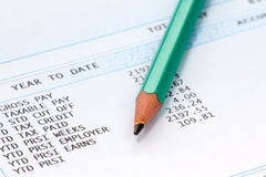 Pencil on the statement of payroll details Royalty Free Stock Photo