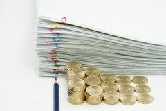 Pencil and step pile of gold coins. With pile overload document with colorful paperclip on white background Royalty Free Stock Image