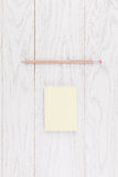 Pencil and sticker paper on wooden background Royalty Free Stock Images
