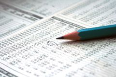 Pencil and stock chart Stock Images