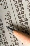 Pencil on Stock Charts Stock Photos