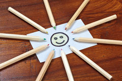 Pencil sun on wooden table Stock Photo