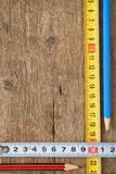 Pencil and tape measure on wood Royalty Free Stock Images