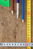 Pencil and tape measure on wood Stock Image