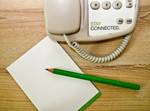 Pencil  telephone and note pad Royalty Free Stock Photos