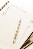 Pencil and textbook. Close up Royalty Free Stock Images