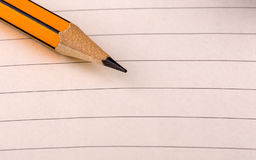 Pencil tip on lined paper. Pencil tip on white lined paper Royalty Free Stock Photography