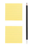 Pencil and two post-it notes on white background. Sharp black pencil and two yellow lined post-it notes Stock Images