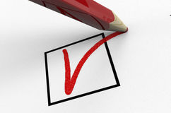 Pencil is voting a ballot,  on white Royalty Free Stock Photos