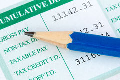 Pencil and wage slip Royalty Free Stock Photos