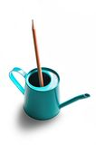 Pencil in watering can Stock Image