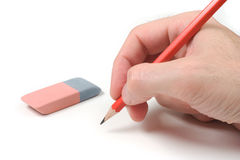 Pencil on White. Hand with pencil over a white background stock image