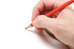 Pencil on White. Hand with pencil over a white background Royalty Free Stock Photos