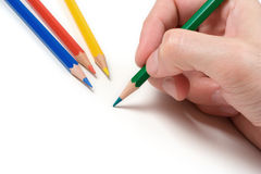 Pencil on White. Hand with pencil over a white background royalty free stock photo