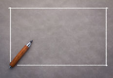 Pencil with white frame. On grey background with copy-space Royalty Free Stock Photography