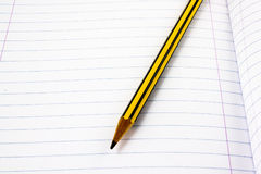 Pencil on a white page Stock Image