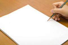 Pencil and white paper close-up view Royalty Free Stock Photos