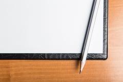 Pencil on white paper Stock Photos
