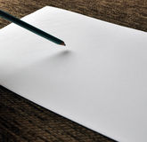 Pencil on white paper Royalty Free Stock Photography