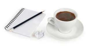 Pencil on a white spiral squared notebook. With cup of coffee on white Royalty Free Stock Photo