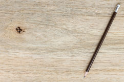 Pencil on wood background Stock Photos