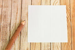 Pencil wood bark with paper on wooden background Royalty Free Stock Images