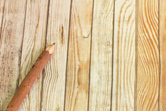Pencil wood bark on wooden background Royalty Free Stock Image