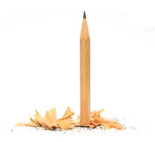 Pencil in wood shavings Royalty Free Stock Images