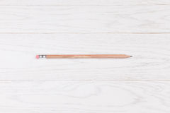 Pencil on wooden background. Wooden pencil on wooden white background Stock Photo