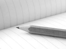 Pencil and workbook Royalty Free Stock Photos