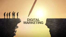 Pencil write `DIGITAL MARKETING`, connecting the cliff. Businessman crossing the cliff, business concept.