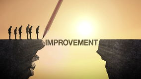 Pencil write 'IMPROVEMENT', connecting the cliff. Businessman crossing the cliff, business concept. stock video