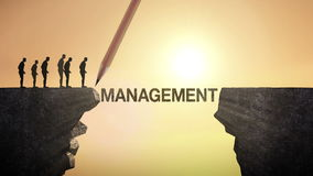 Pencil write 'MANAGEMENT', connecting the cliff. Businessman crossing the cliff, business concept.